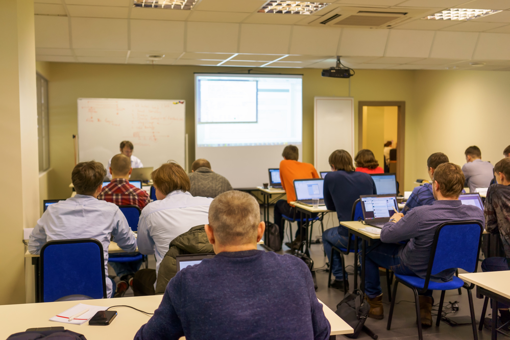 people sitting rear at the computer training class